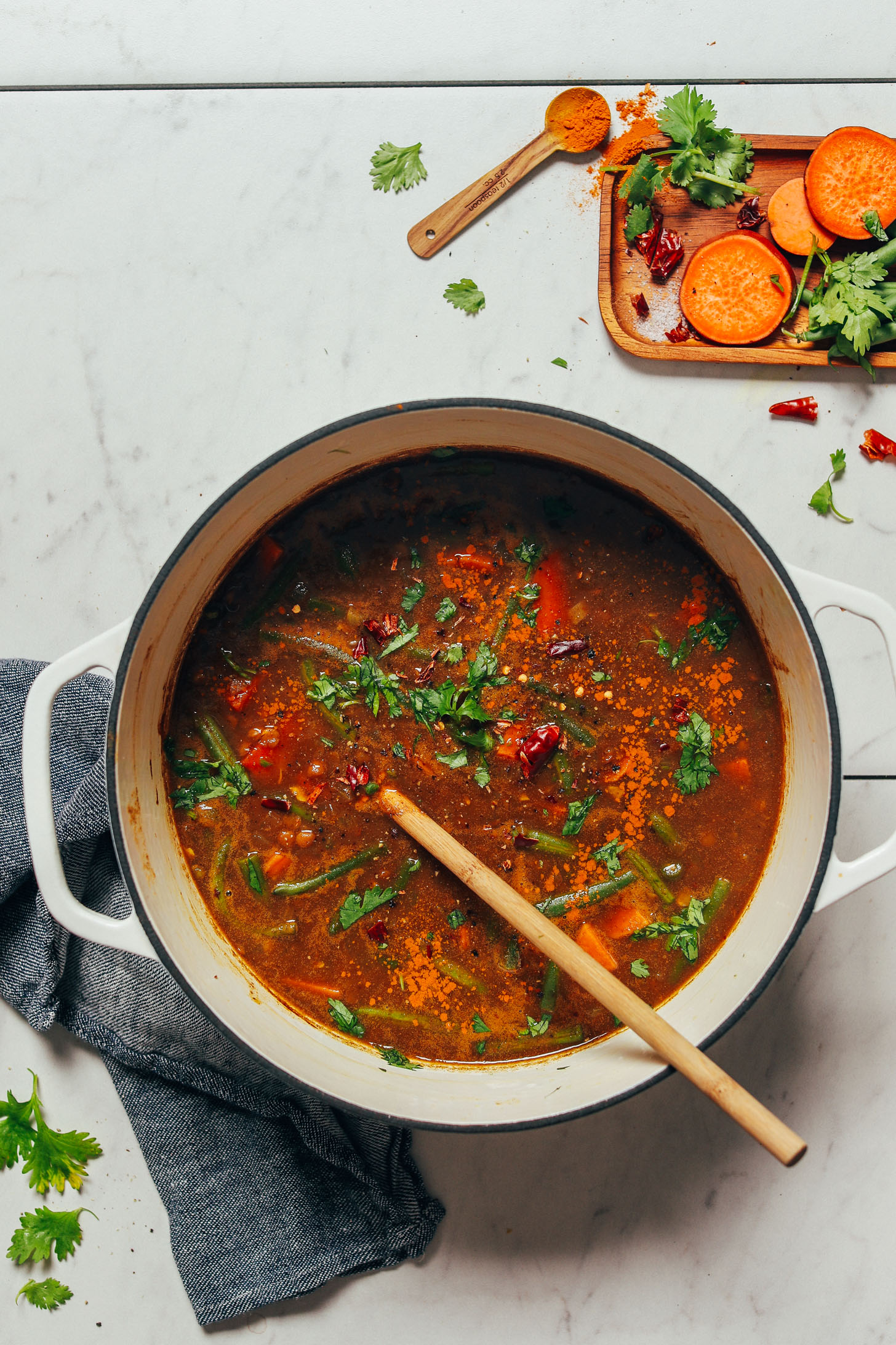 Freshly parsley sprinkled over a pot of our Spiced Sweet Potato Lentil Soup recipe