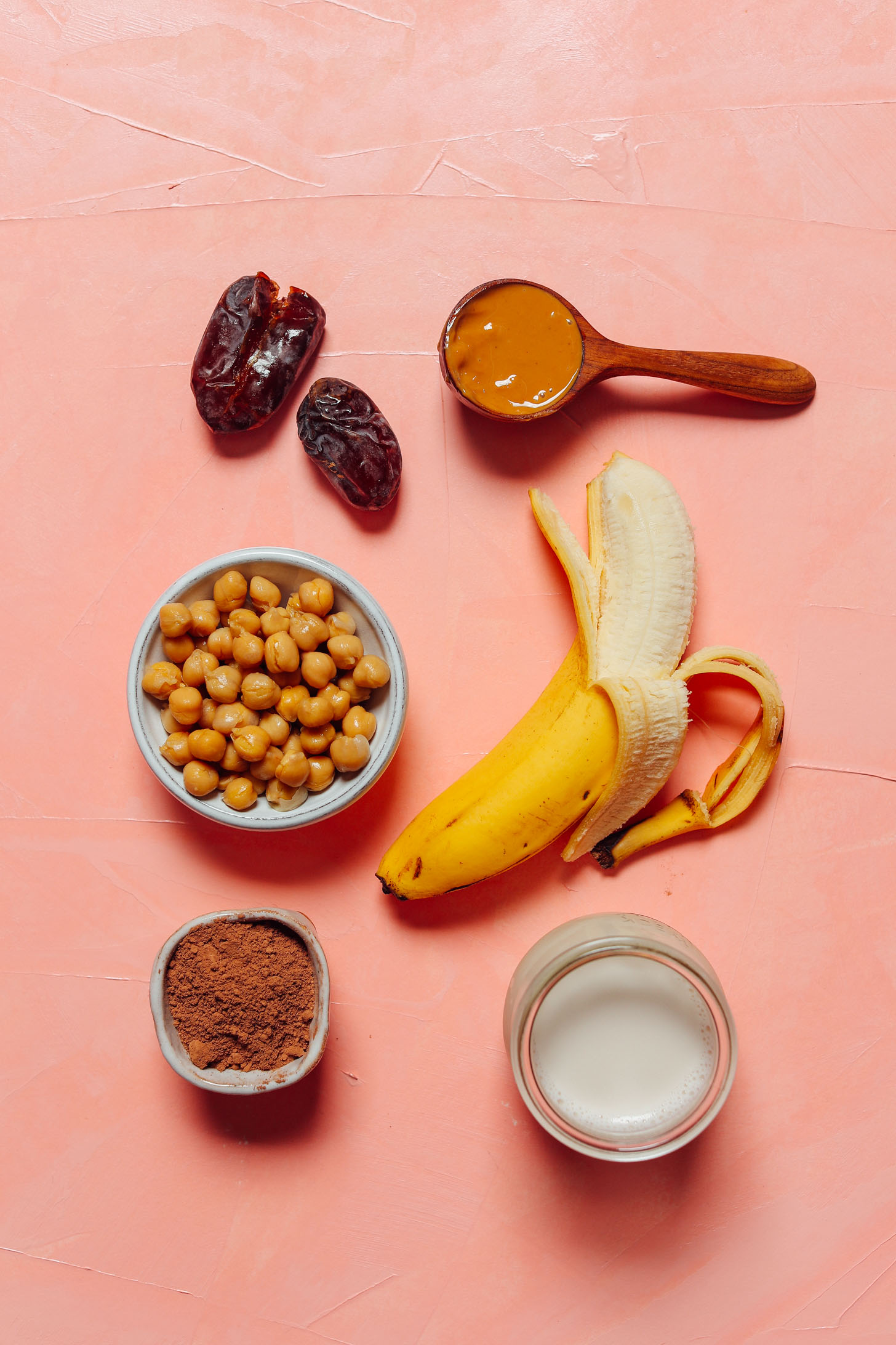 Bananas, chickpeas, dates, and other ingredients for making a Vegan Chocolate Chickpea Shake recipe