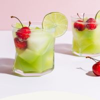 Two glasses of Citrus Melon Spritzers with cherries for a refreshing summer drink