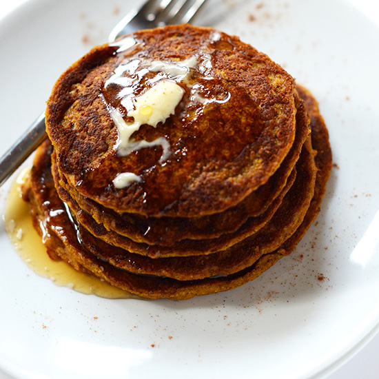 Plate of Vegan Pumpkin Spice Pancakes topped with syrup