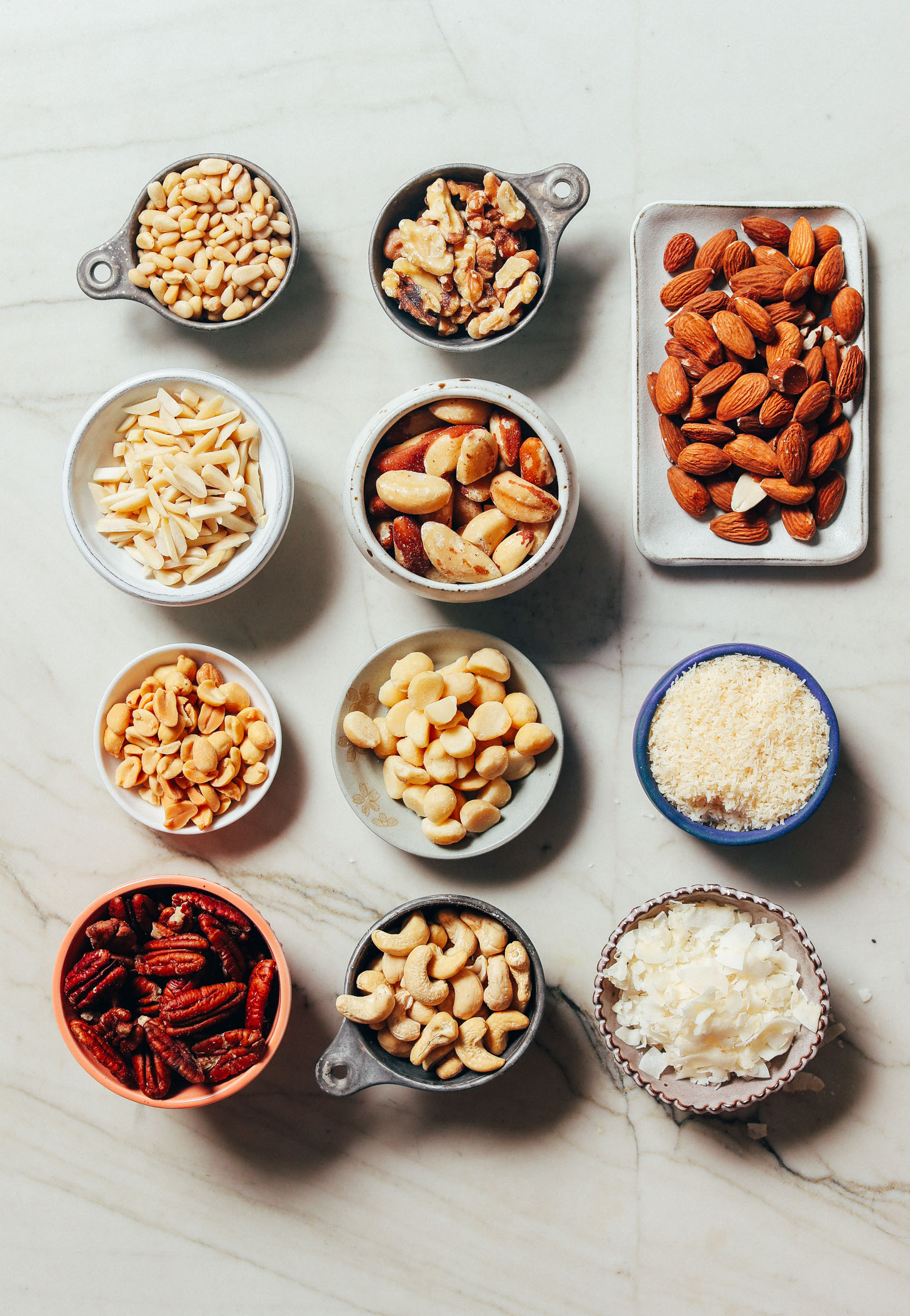 Various nuts and seeds included in our guide on How to Stock Your Pantry