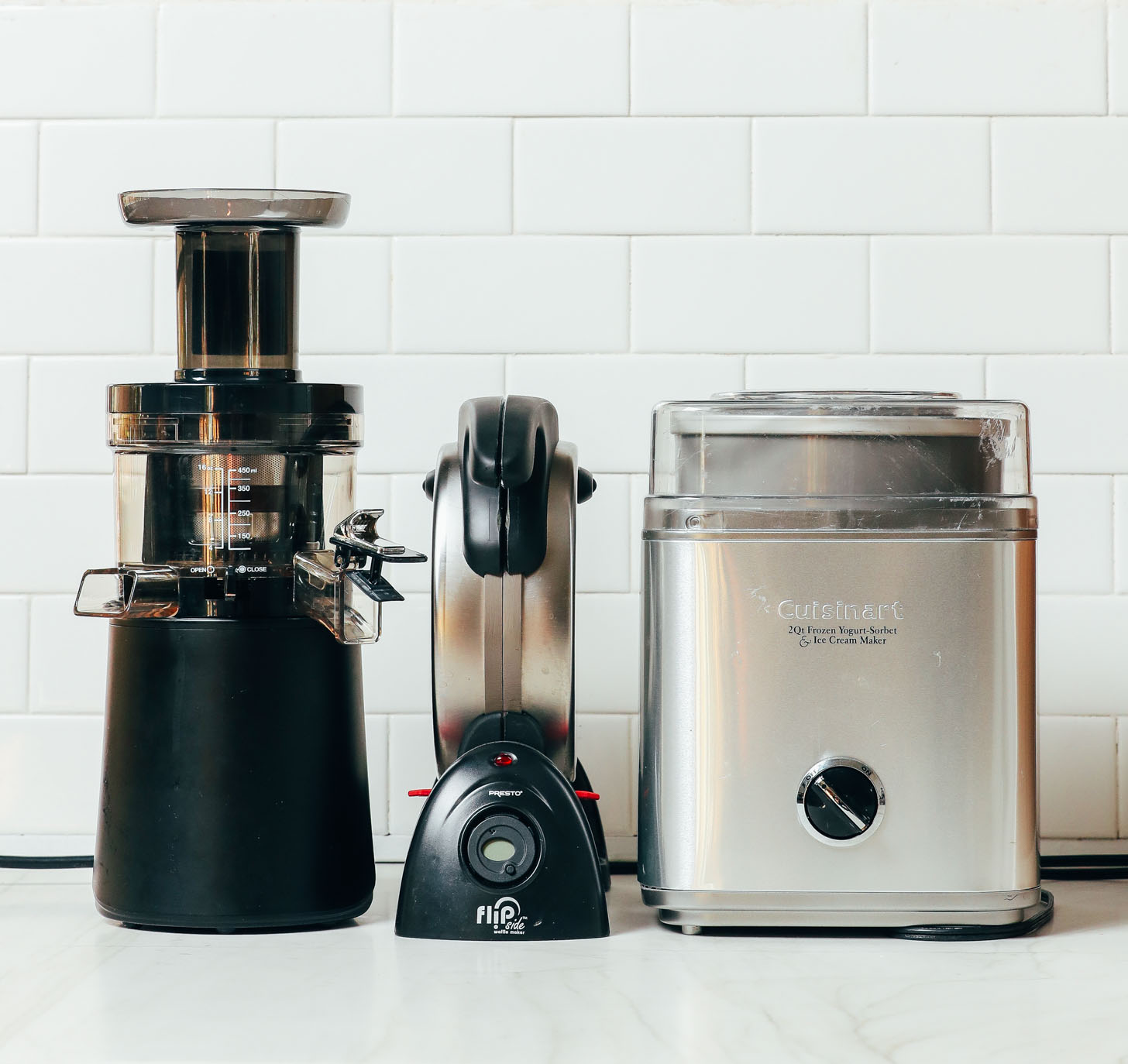 A juicer, waffle maker, and ice cream maker as some of the kitchen appliances we recommend in our guide on How to Stock a Pantry