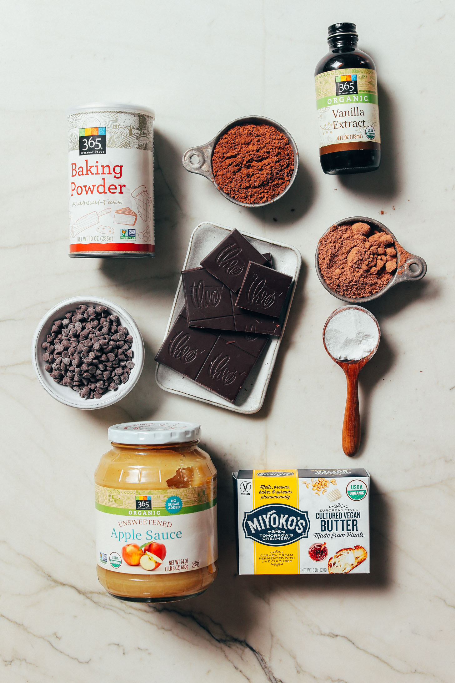 Applesauce, vegan butter, and other baking supplies for stocking a pantry for vegan baking