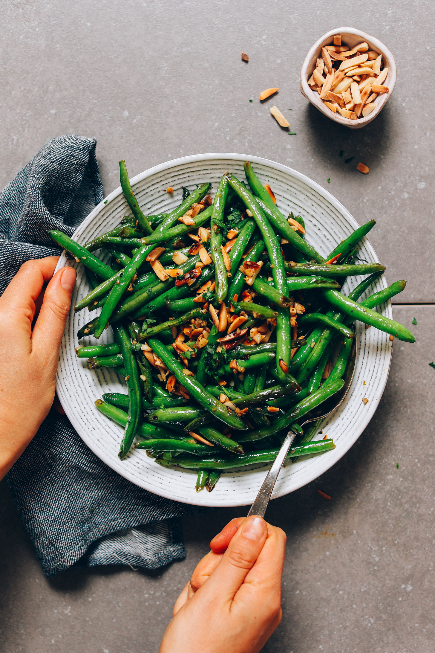 Bowl of our Garlic Green Beans recipe topped with slivered almonds