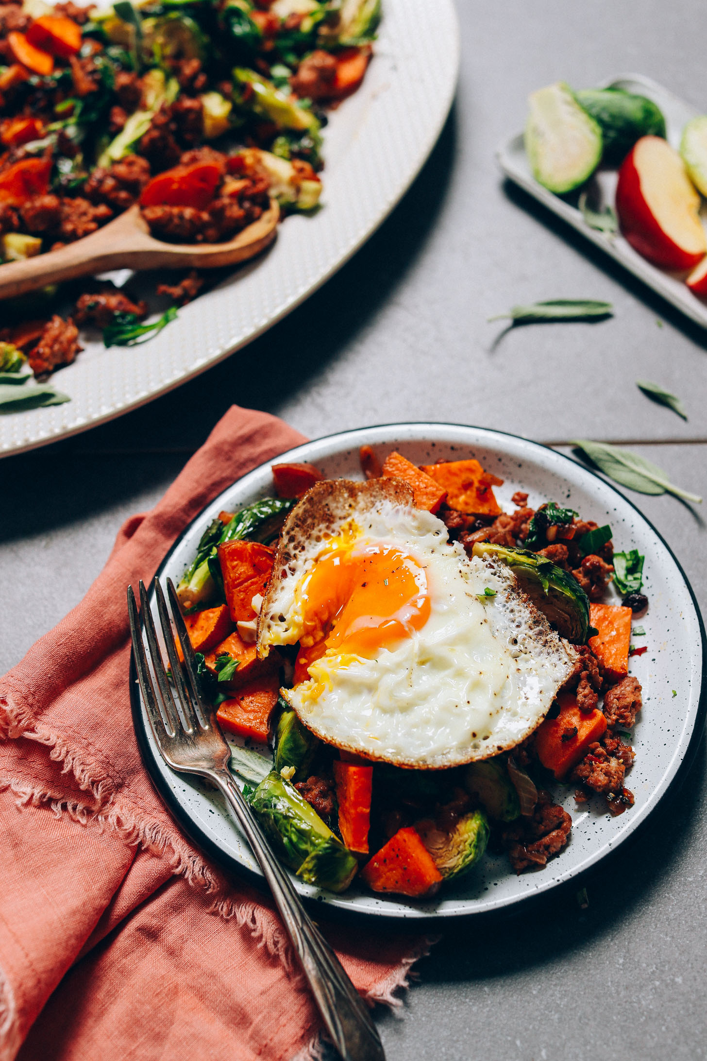 Sunny side up egg atop our Sweet Potato Breakfast Hash perfect for fall