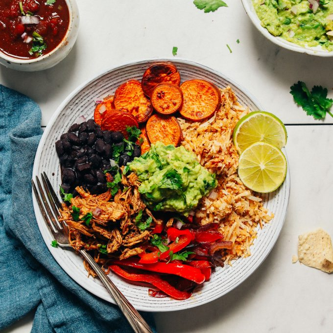 Grain-Free Burrito Bowl made with cauliflower rice, peppers, black beans, and sweet potatoes