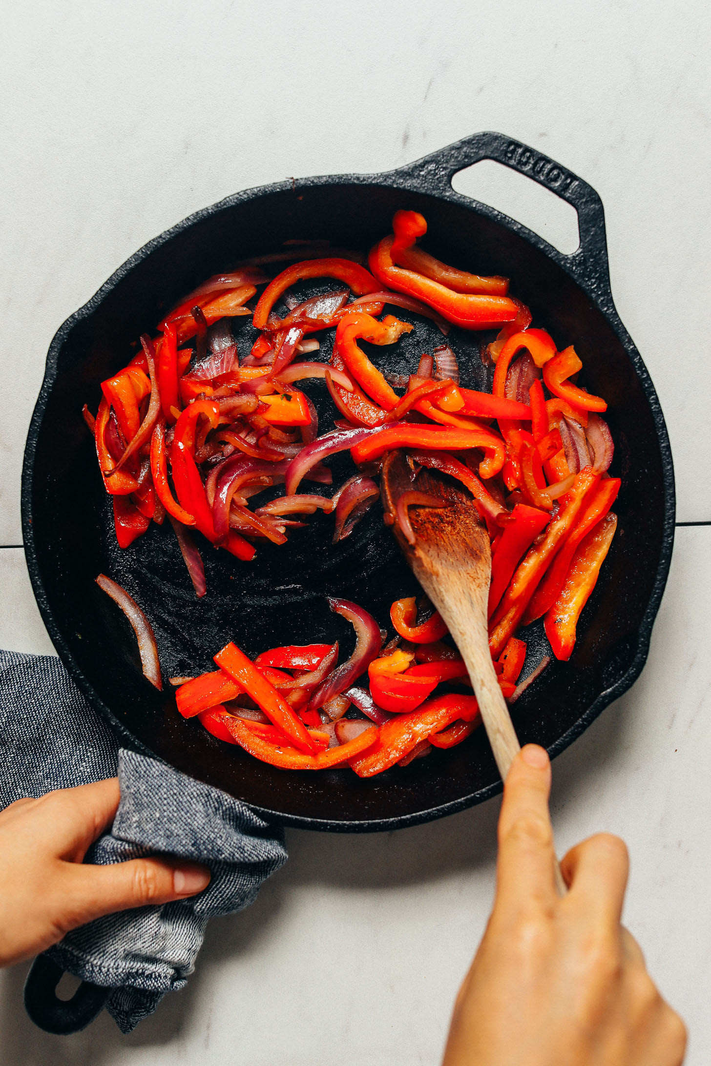Sautéing peppers and onions for our Grain-Free Burrito Bowls recipe