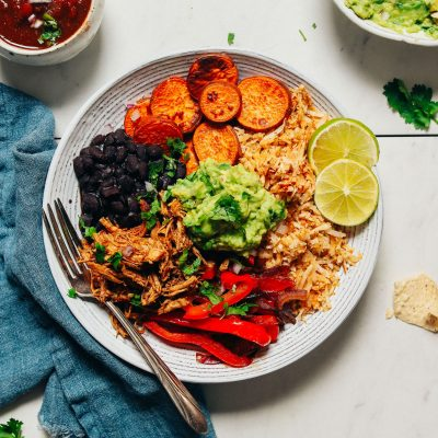 Fork resting in a Grain-Free Burrito Bowl topped with guacamole