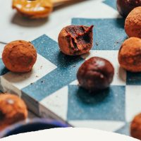 Date-Sweetened Chocolate Truffles on a blue and white tile