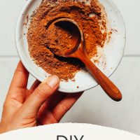 Small wooden spoon in a bowl of DIY Pumpkin Pie Spice