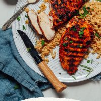 Plate of quinoa topped with our Marinated Grilled Chicken Breast recipe