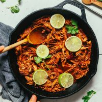 Pan of Shredded Mexican Chicken cooked in a cast iron skillet