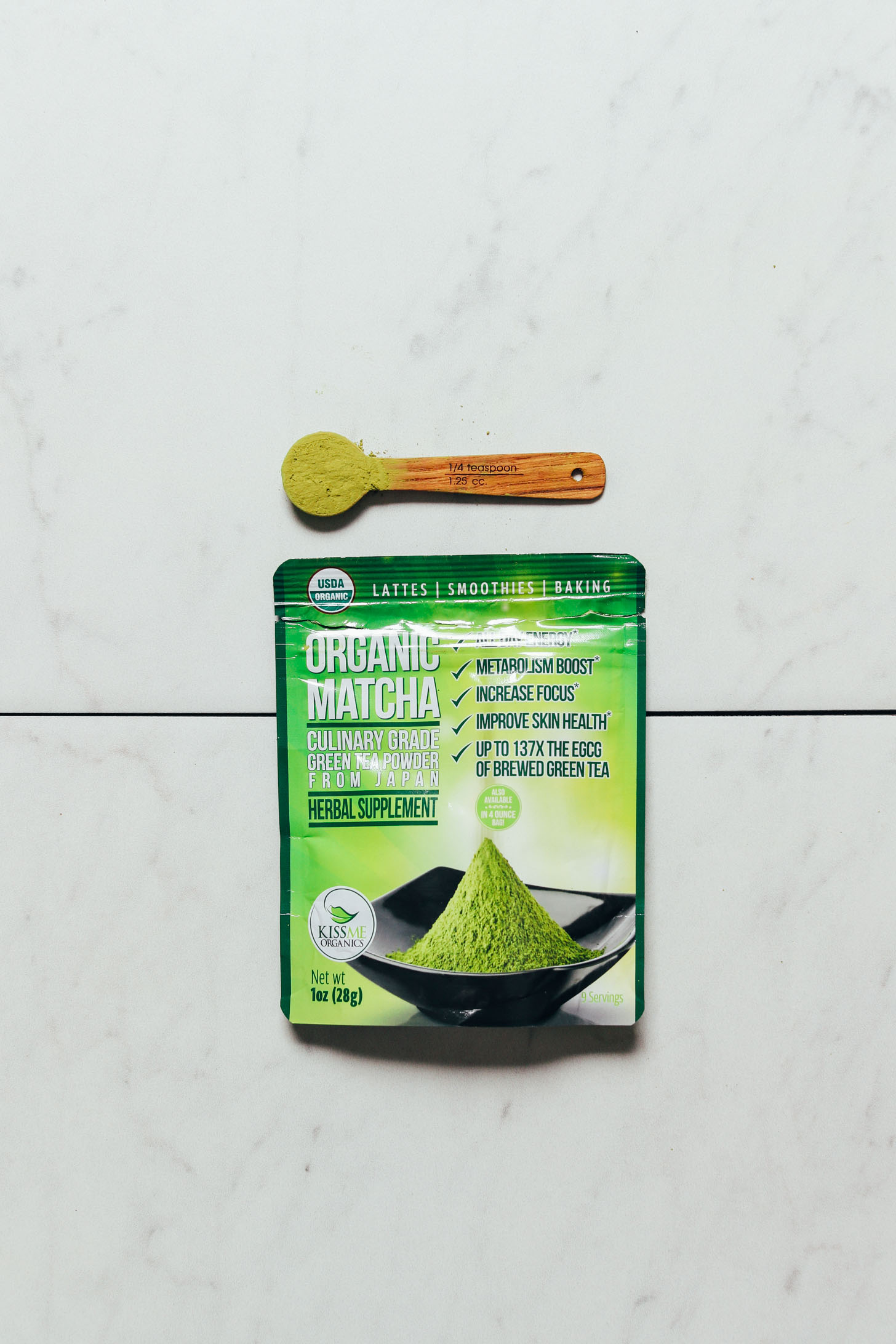 Packet and spoonful of Kiss Me Organics Culinary Matcha for our roundup of the best brands of matcha powder