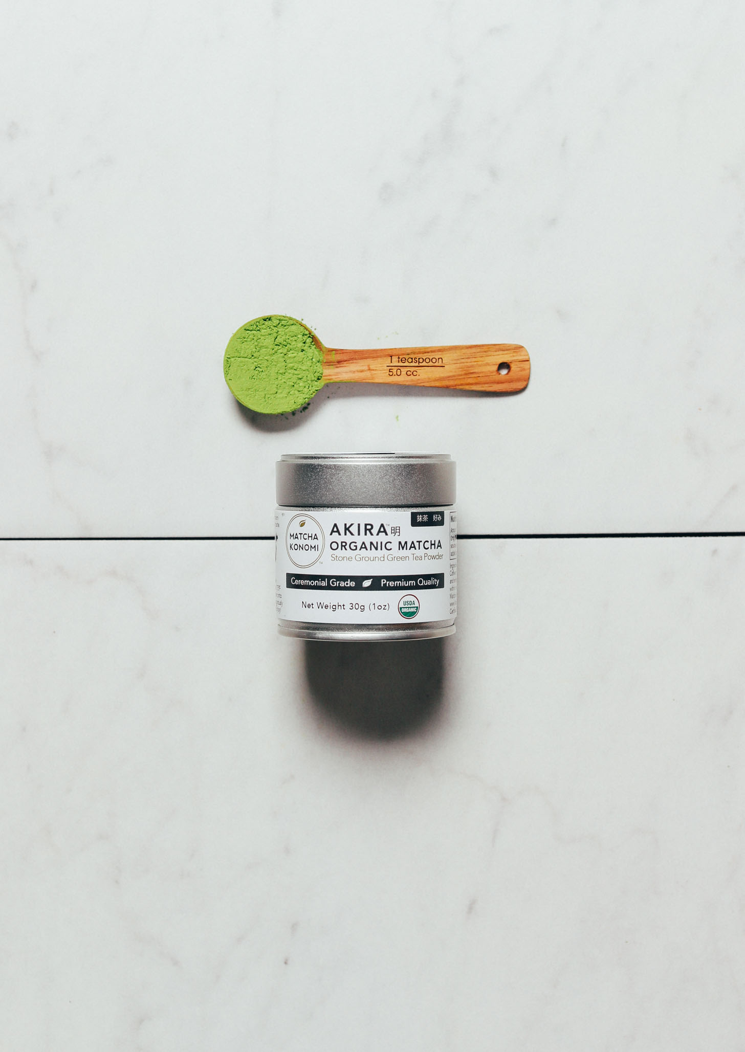 Spoonful and jar of Matcha Konomi Akira Matcha Powder for our review of the best brands of matcha