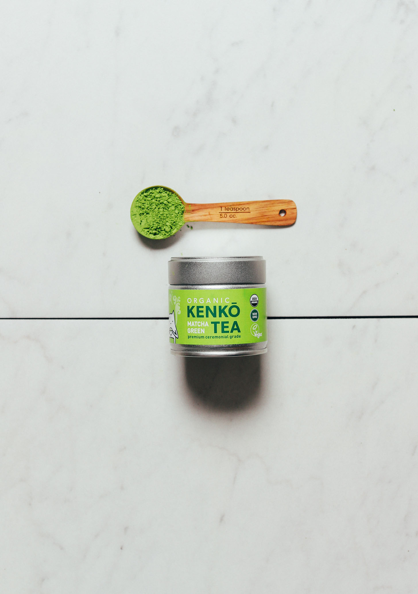 Spoon and jar of Kenko ceremonial matcha for our review of matcha brands