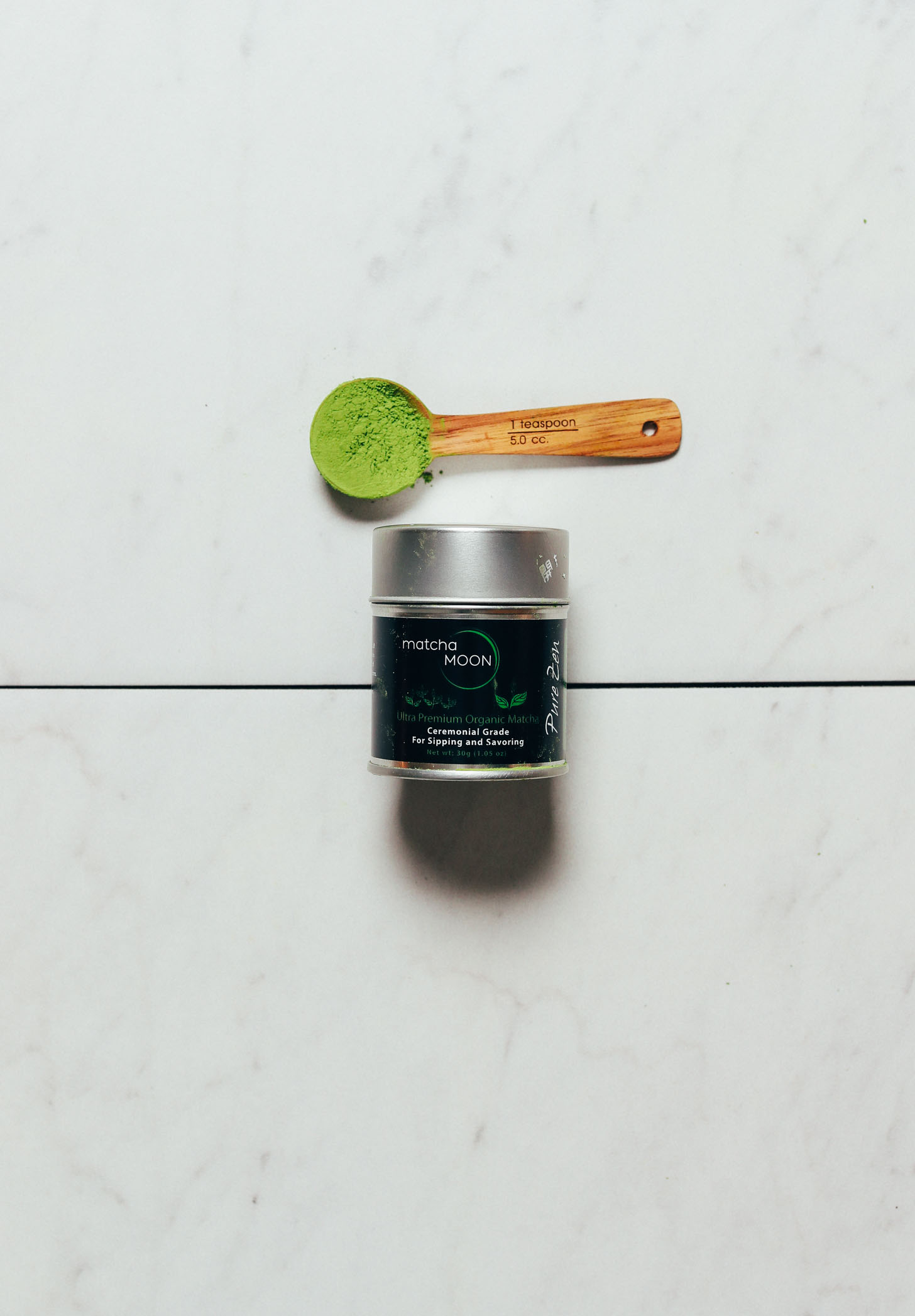 Spoonful and jar of Matcha Moon for our review of the best brands of ceremonial matcha