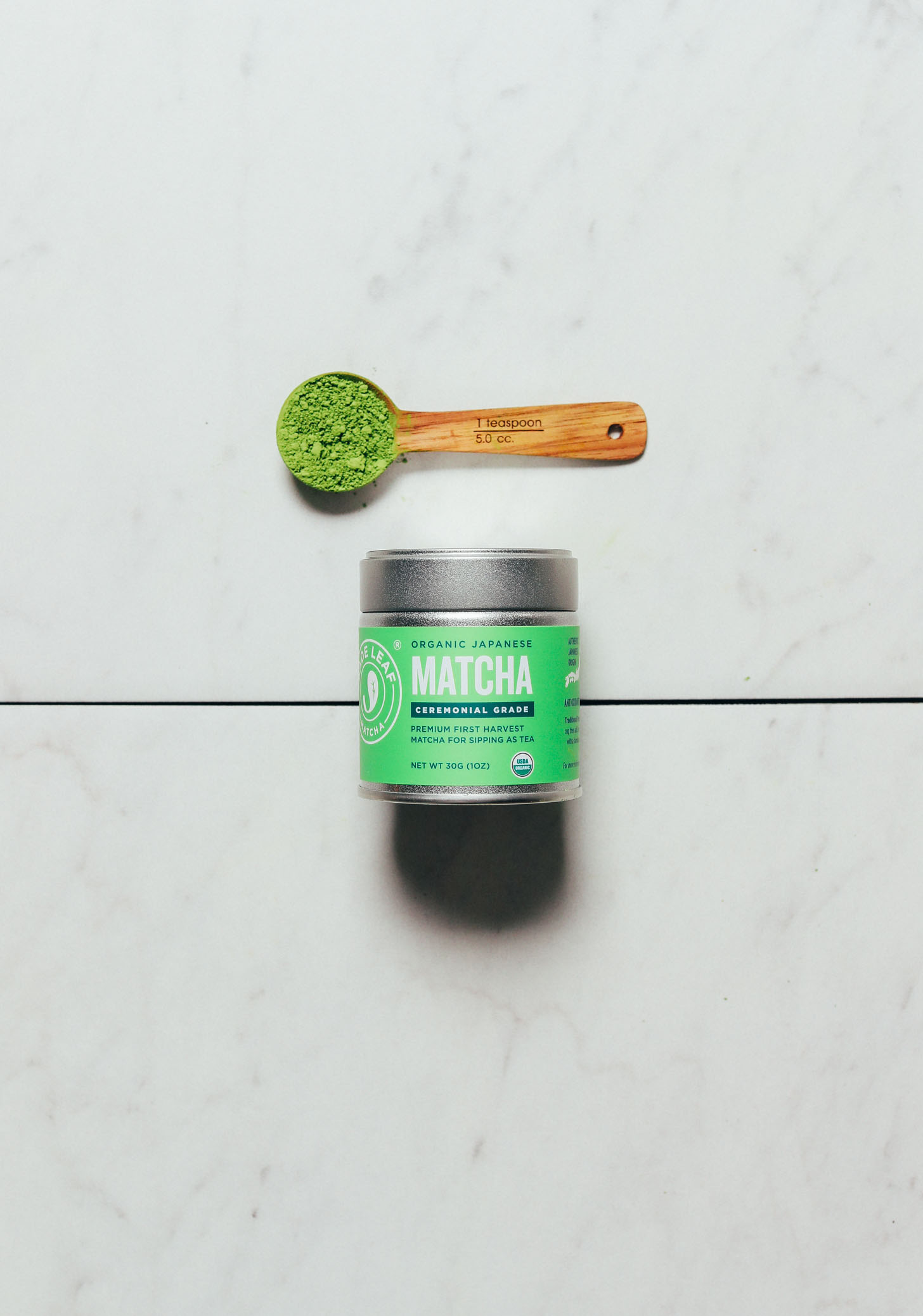 Spoonful and jar of Jade Leaf Ceremonial Matcha for our review of the best brands of matcha
