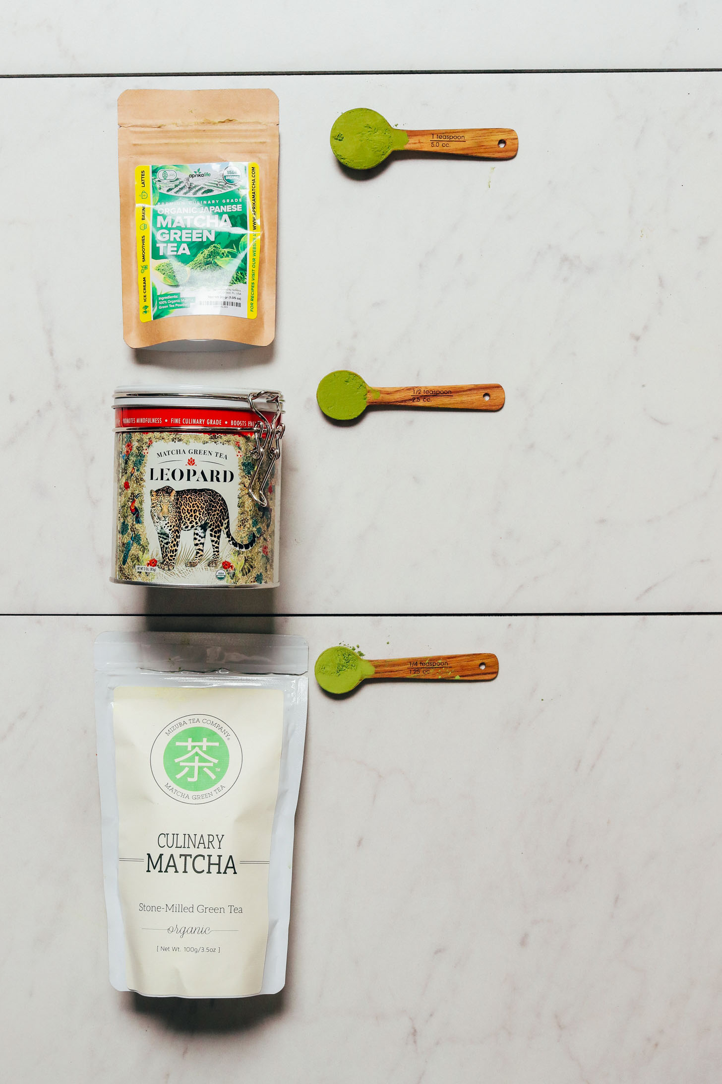 Spoonfuls and containers of our favorite brands of matcha