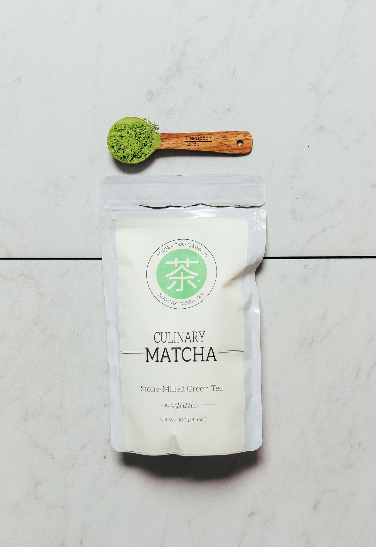 Spoonful and package of Mizuba Culinary Matcha for our review of the top matcha brands