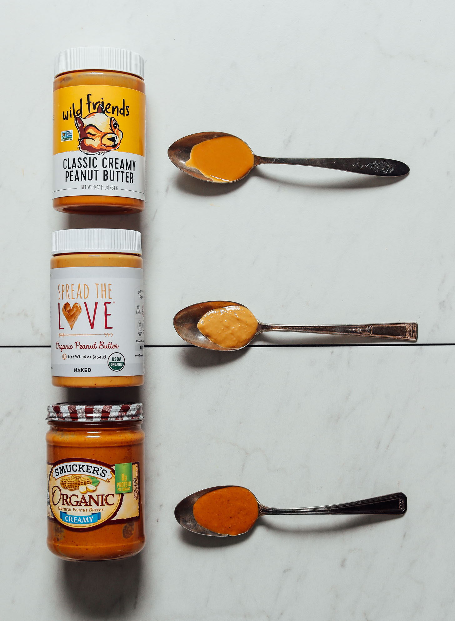 Jars and spoonfuls of our top three favorite brands of peanut butter