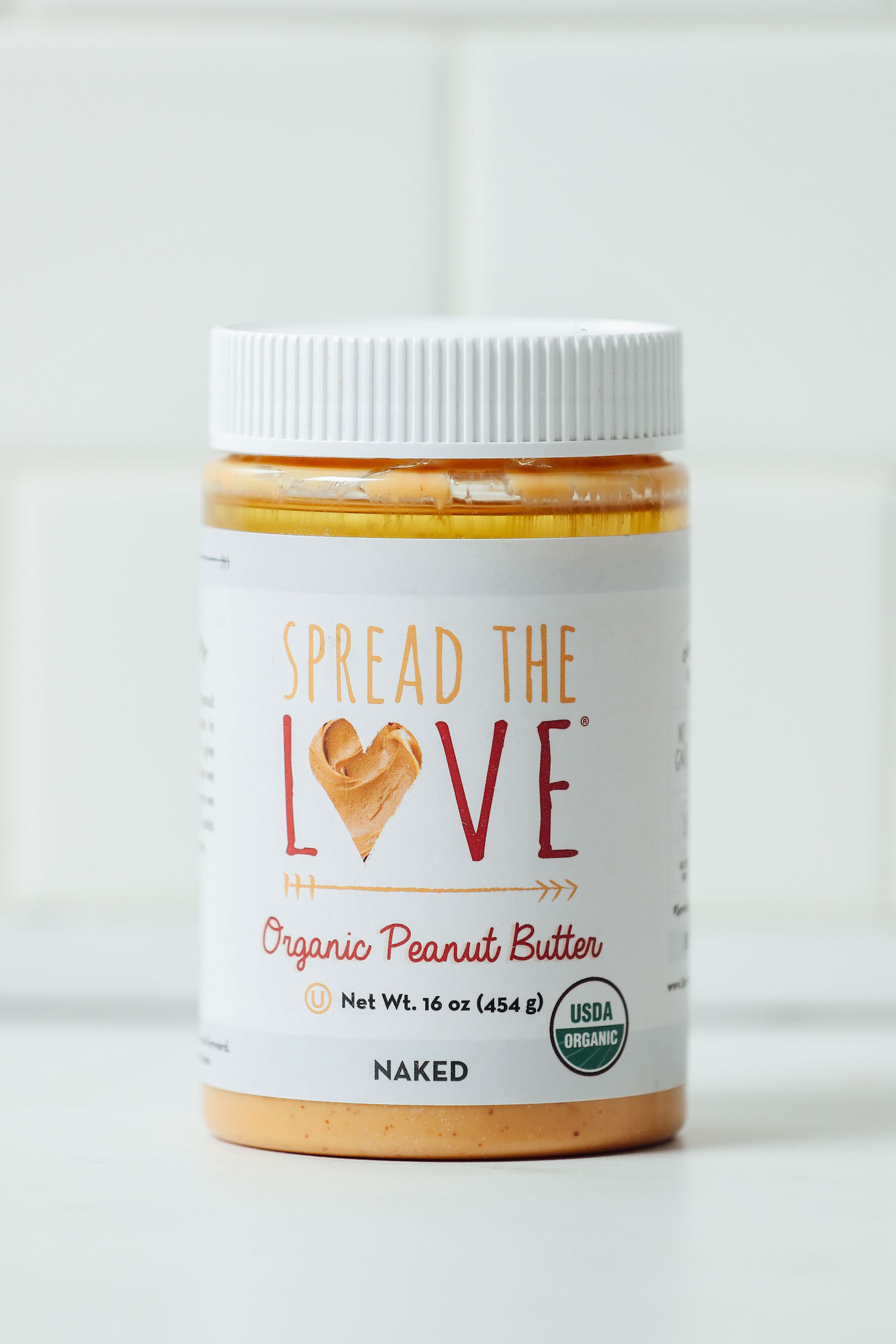 Jar of Spread the Love Peanut Butter for our review of the best brands of peanut butter