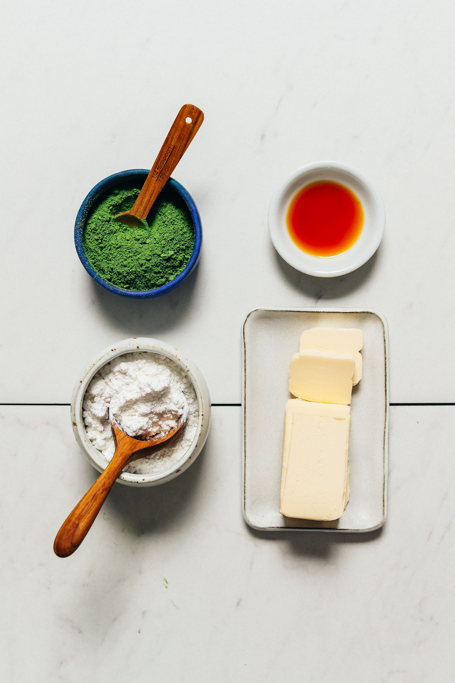 Vegan butter, matcha, powdered sugar, and vanilla for making our Vegan Matcha Frosting recipe