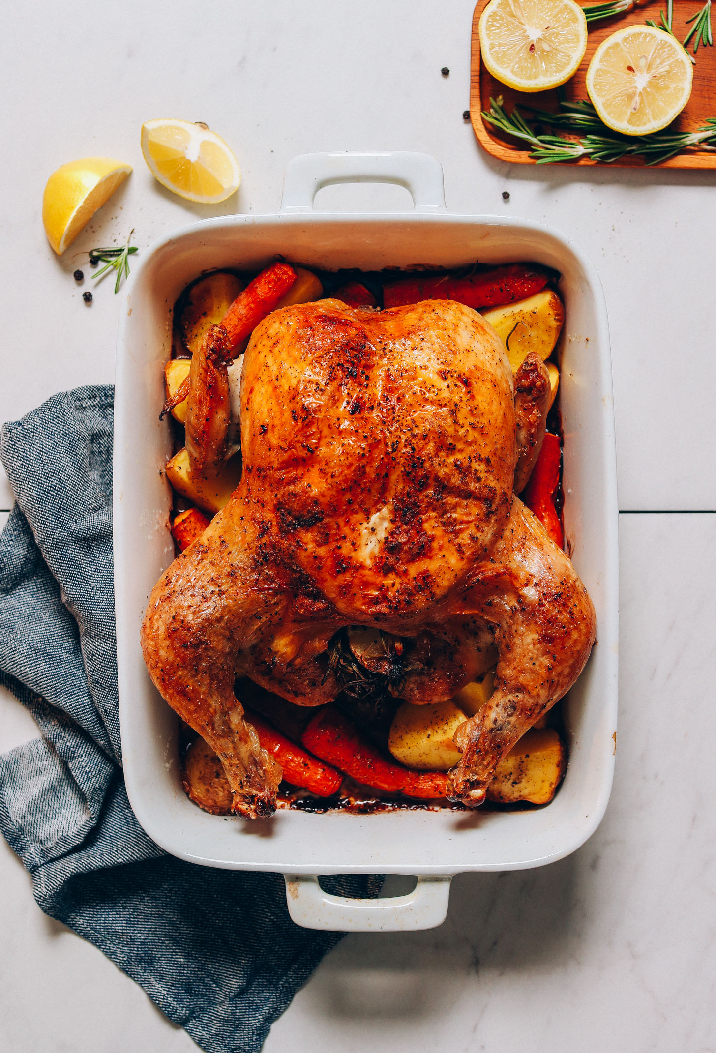 Perfectly cooked Oven Roasted Chicken in a ceramic dish