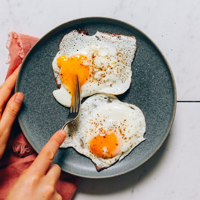 Plate of perfectly cooked sunny side up eggs for our tutorial on How to Cook an Egg