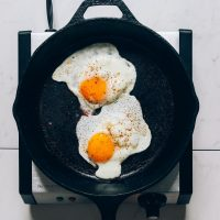 Eggs in a skillet for our tutorial on How to Fry an Egg