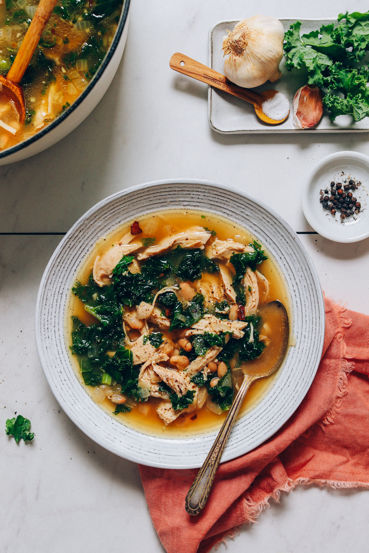 Bowl of grain-free Chicken Soup made with kale and white beans