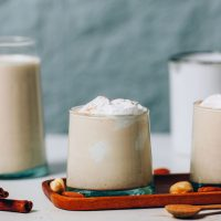 Glasses of our Vegan Eggnog recipe for a festive holiday drink