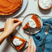 Biting into a slice of our 1-Bowl Pumpkin Pie recipe