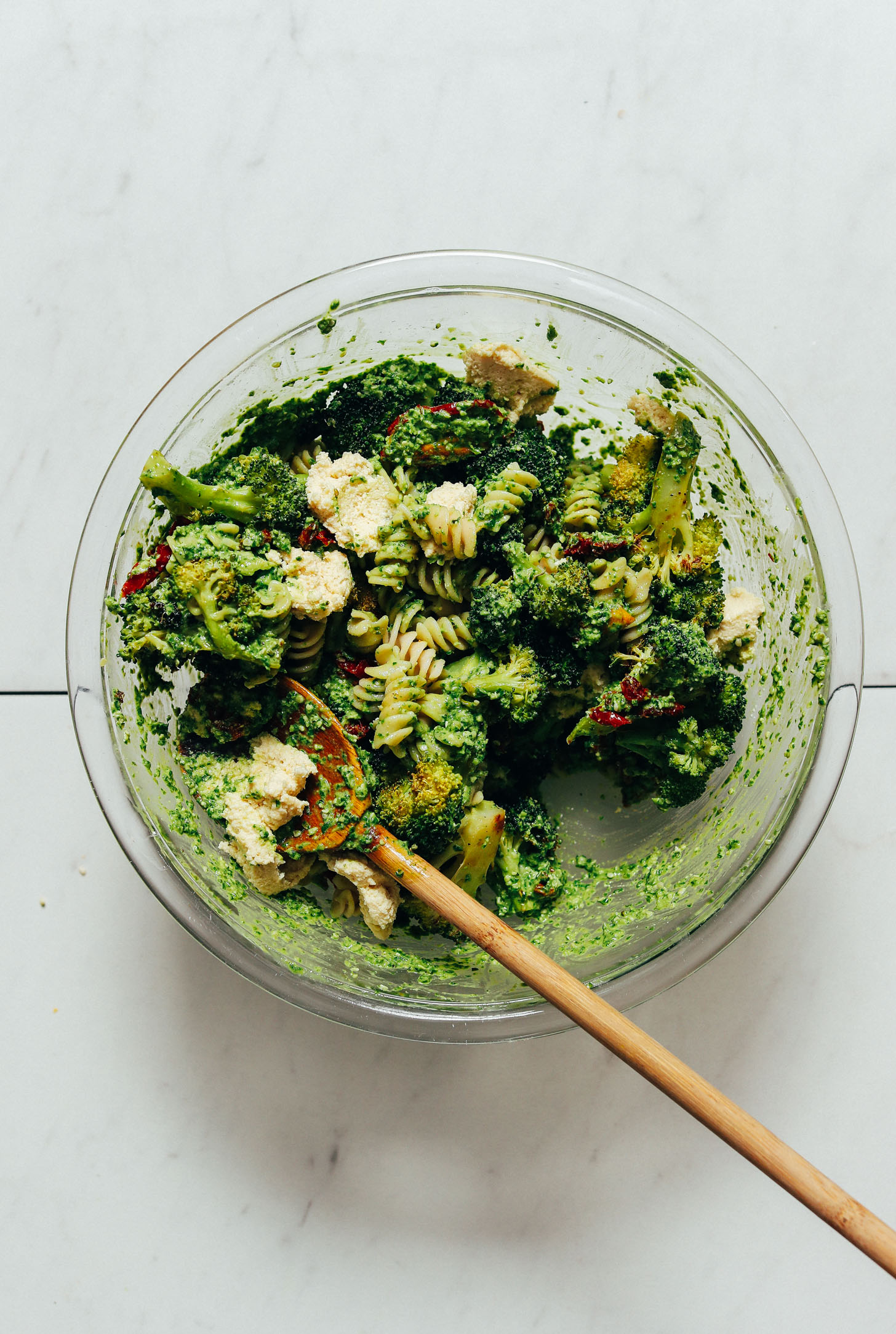 Bowl of Pesto Broccoli Pasta Salad with Sun-Dried Tomatoes and Vegan Macadamia Nut Cheese