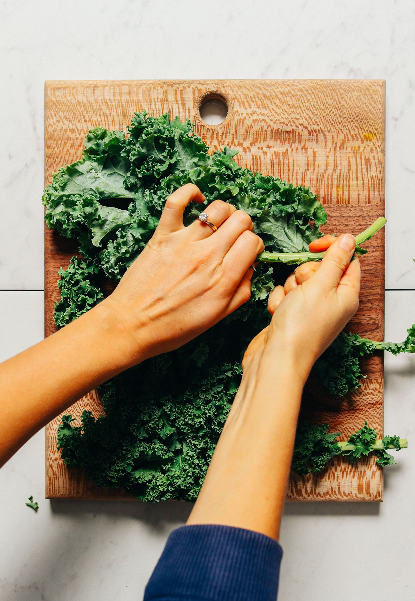 Removing the stems from kale to make our Easy Massaged Kale Salad recipe