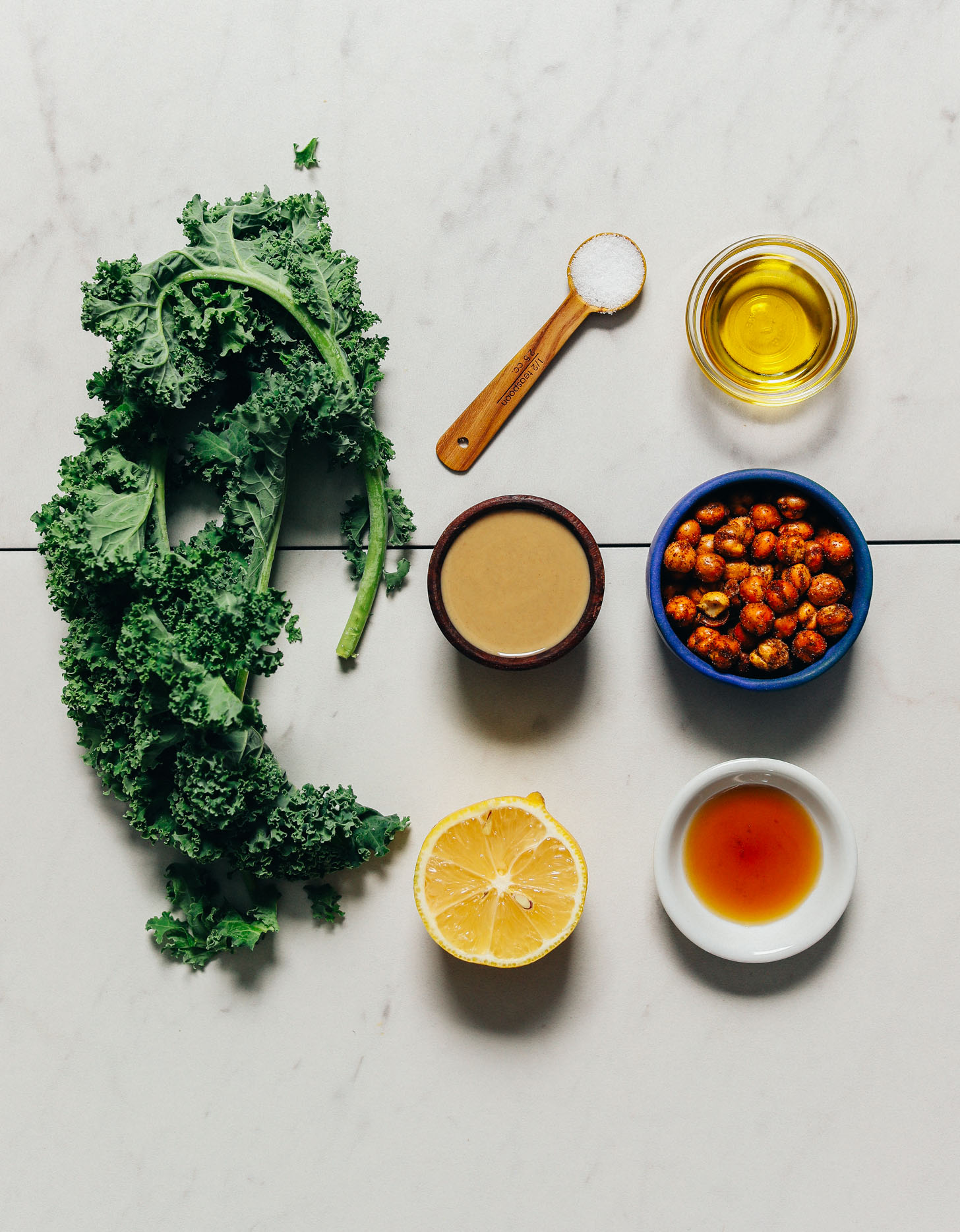 Kale, tahini, chickpeas, and other ingredients for making our Easy Massaged Kale Salad