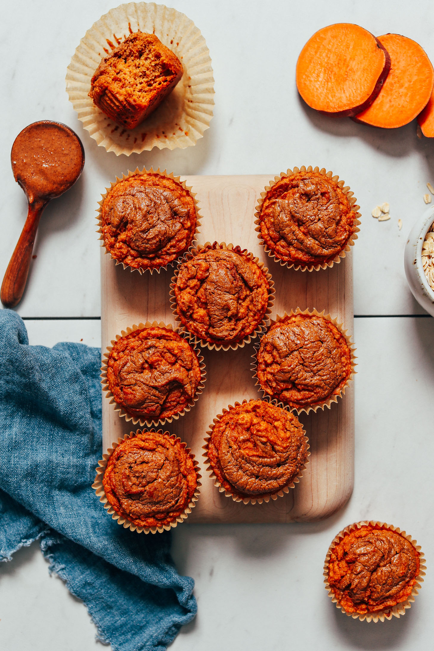 Batch of our Almond Butter Sweet Potato Muffins on a cutting board