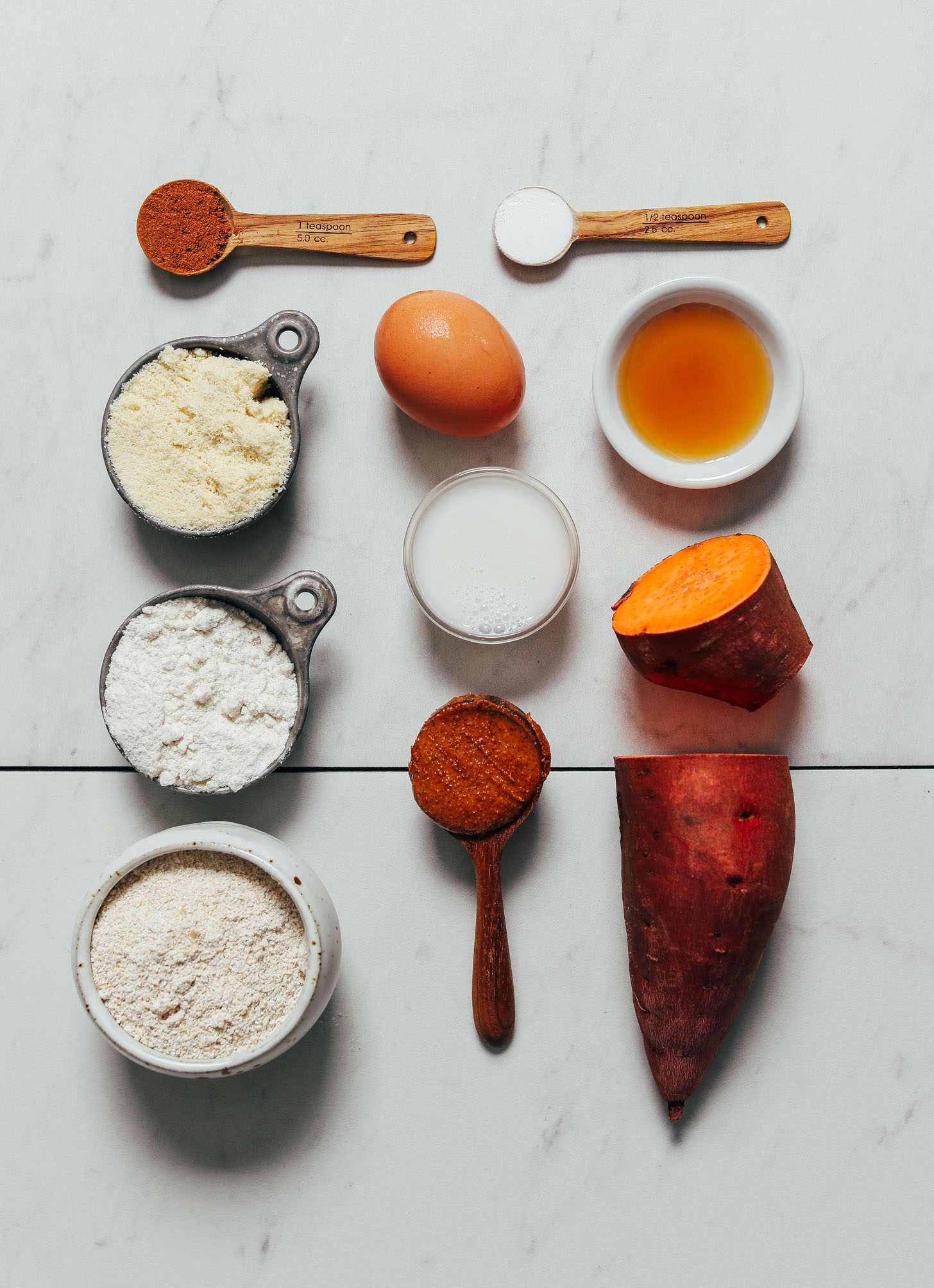 Sweet potato, egg, dairy-free milk, and other ingredients for making our Almond Butter Sweet Potato Muffins