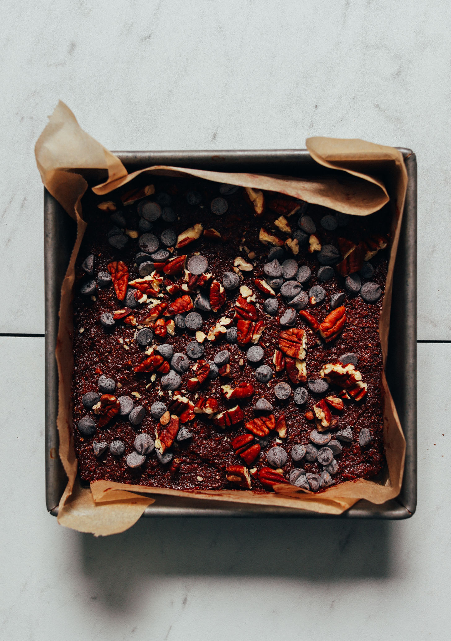 Parchment-lined baking pan filled with a batch of Fudgy Gluten-Free Sweet Potato Brownies