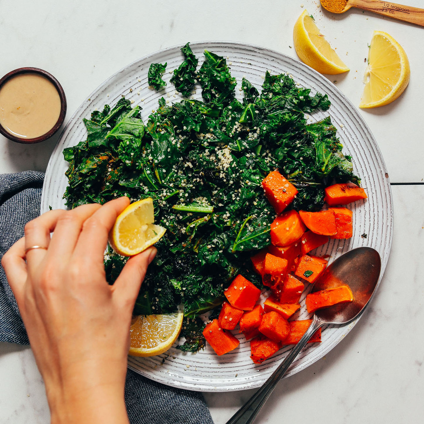 Squeeze a lemon wedge over sautéed kale