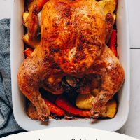 Pan of roasted vegetable and chicken made with lemon and rosemary