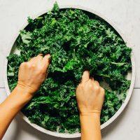 Massaging kale for our Easy Kale Salad recipe