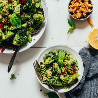 Bowls of Broccoli Pesto Pasta Salad made with gluten-free pasta