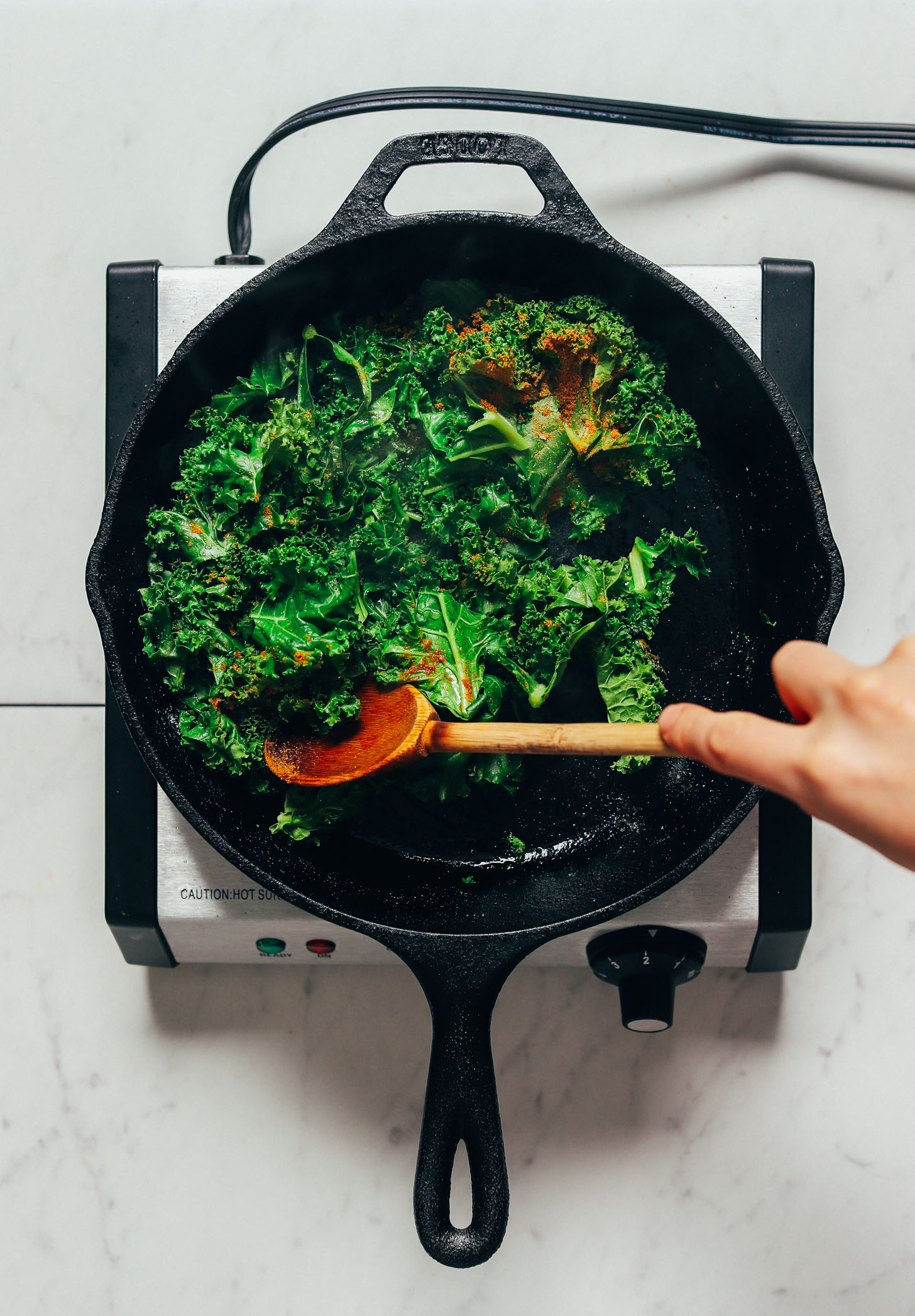 Sautéing kale in a cast iron skillet