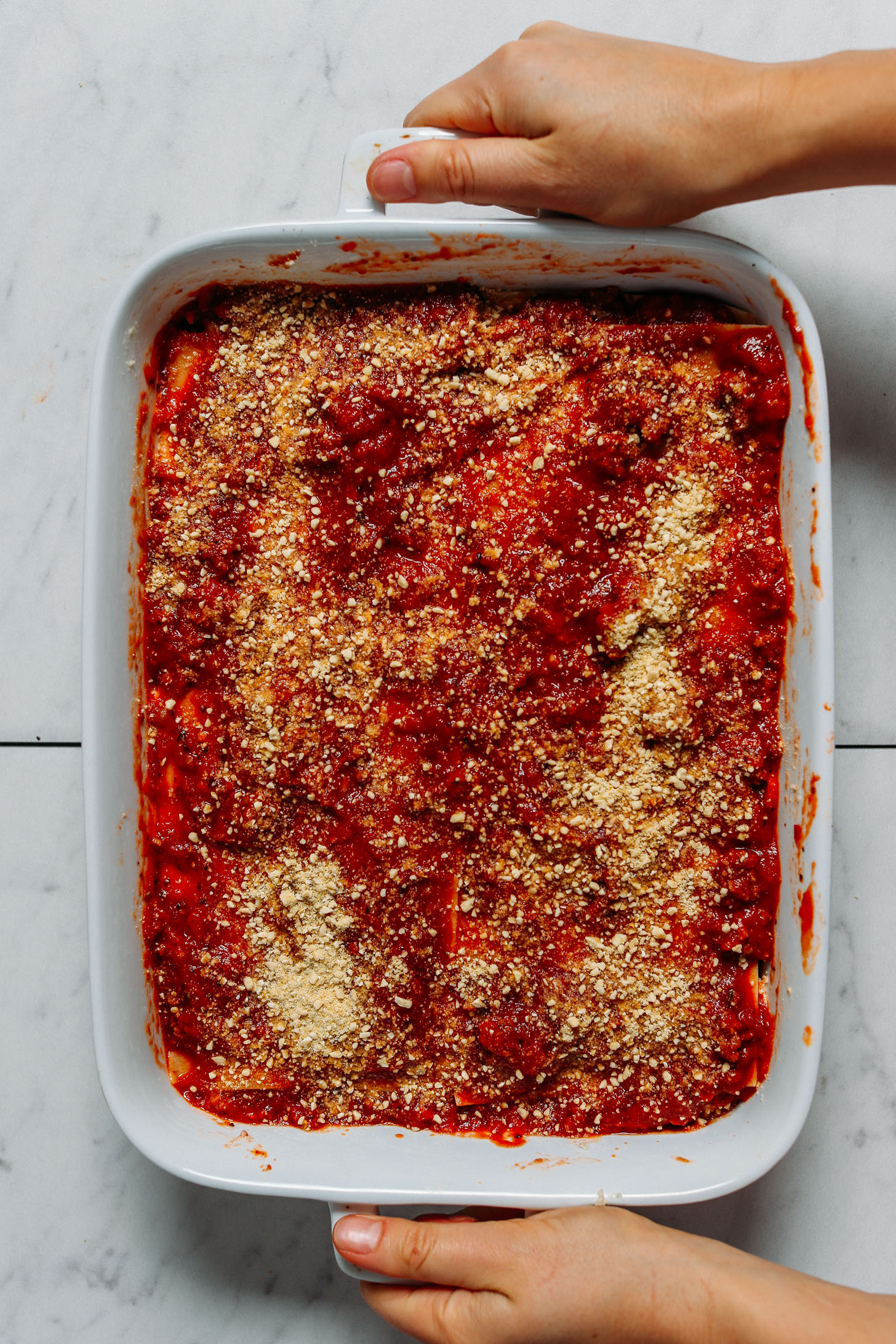 Holding the handles of a pan of our Dairy-Free Gluten-Free Lasagna recipe