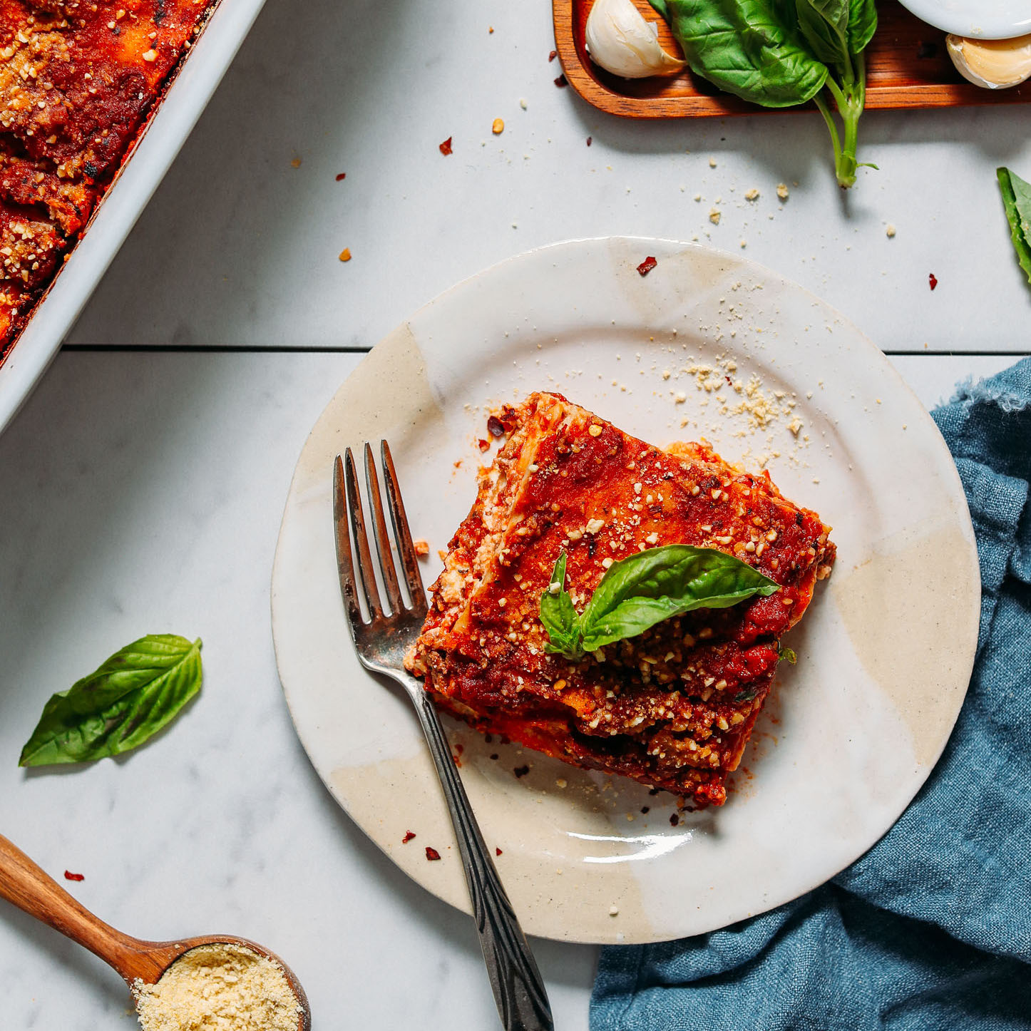 Top view of a slice of Dairy-Free Gluten-Free Lasagna topped with fresh basil