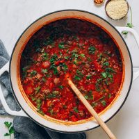 Wooden spoon in a big pot of Tuscan Beef Soup with Lentils