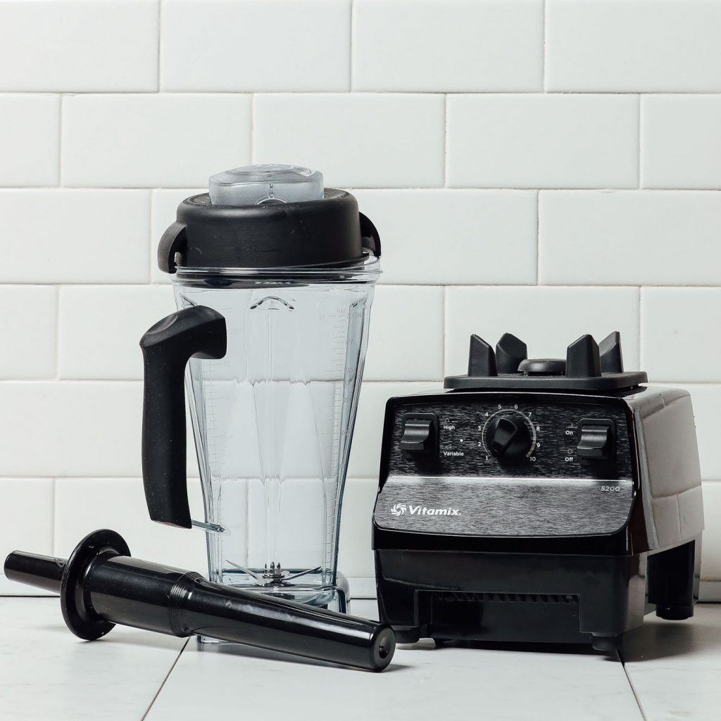 Vitamin blender and Vitamix base with Classic Tamper for processing thick mixtures