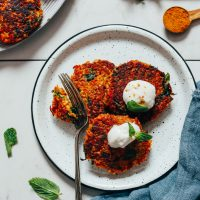 Using a fork to slice into Quinoa Sweet Potato Fritters