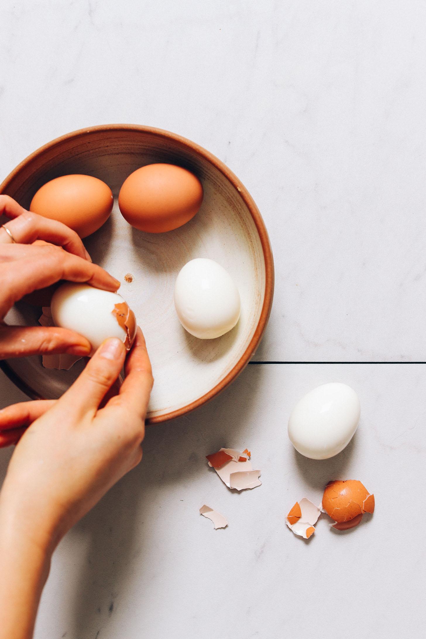 Peeling hard boiled eggs for our Deviled Eggs recipe
