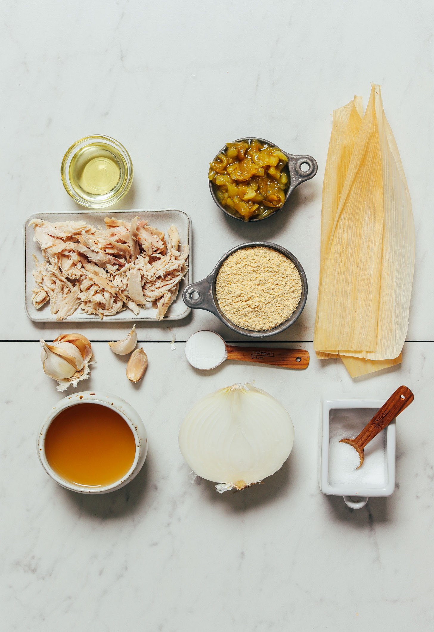 Shredded chicken, masa harina, and other ingredients for making our homemade Chicken Tamales recipe